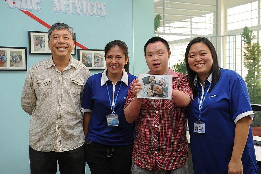 Mr Liew Chong Pow (far left) with his son Jonathan and Minds staff (from left) Joie Aludino and Koh Chu Wen at the group's new facility at Kembangan-Chai Chee Community Hub. The building houses a Caregivers Support Services Centre and a day activity