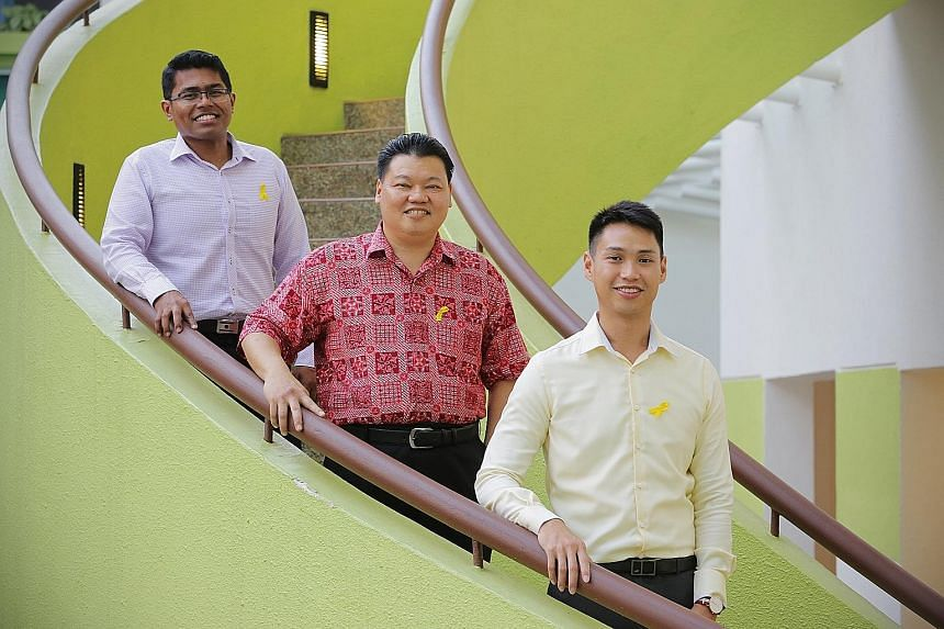 Mr Mohamed Fazly (far left) says volunteers on the SPS' befriending programme such as Mr Azman Osman (centre) are part of a vital support system for former offenders. Mr Azman and Mr Tan Han Yao (at right), who tutors inmates taking their O levels at