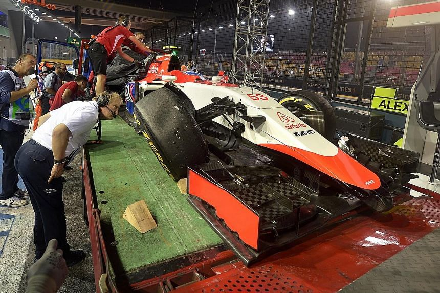 Alexander Rossi, 23, had a baptism of fire on his F1 debut for tail-enders Manor Marussia when he hit the barriers at Turn 18 with three minutes to go before the end of the 90-minute first practice session. The American, flown in at short notice to r