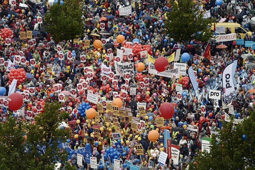 Tens of thousands of people demonstrating at the Central Railway Station in Helsinki, Finland, yesterday. They were against government measures that they say would hit the weakest earners the hardest.