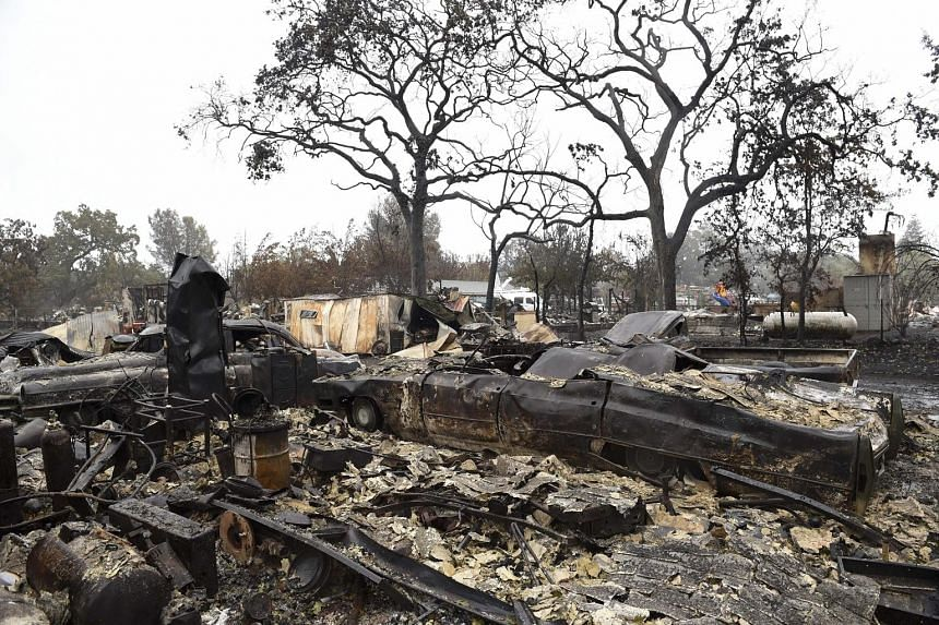The NOAA report comes as wildfires in California continue to wreak havoc amid a sustained drought that some have linked to climate change. Right and far right: What's left of Mr Larry Menzio's tyre shop after the so-called Valley Fire swept through t