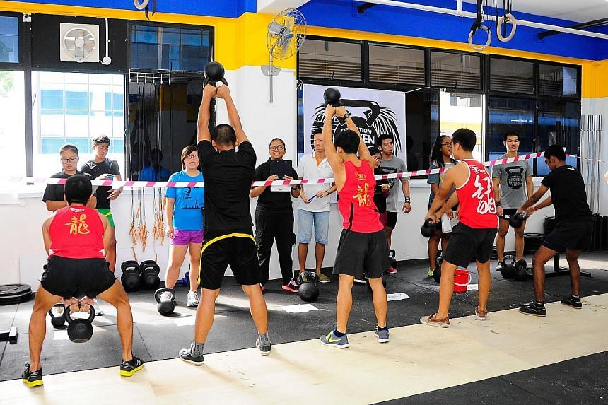 Youth beneficiaries training at Innervate CrossFit gym, the organiser of today's Operation Broken Wing event to raise money for young people helped by Reach Community Services Society. Nineteen youth at risk were picked to participate in this year's