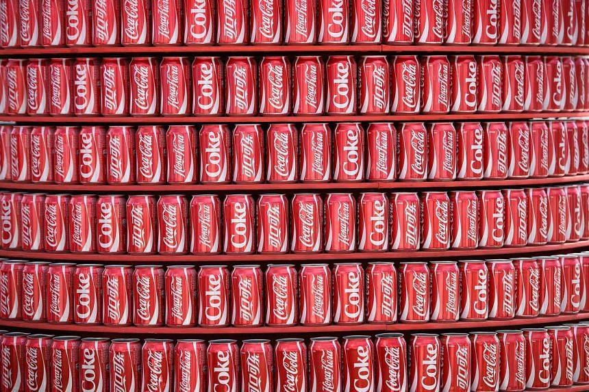 A stack of Coca Cola drink cans in a 2014 file photo.