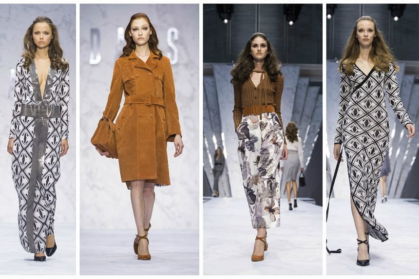 Models presents creations from the Daks collection.