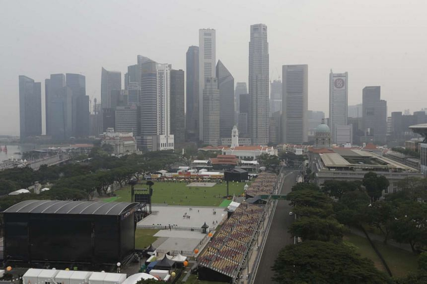 Hazy conditions at the Singapore Grand Prix as seen from Swissotel the Stamford at 4.20pm on Sept 18.