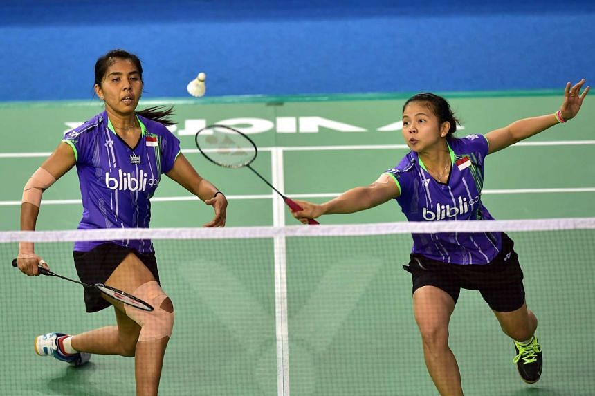 Nitya Krishinda Maheswari (left) and Greysia Polii (right) of Indonesia hit a return against Wang Xiaoli and Yu Yang of China during their women's doubles quarter-final match at the Korea Open Superseries badminton tournament in Seoul on Sept 18, 201