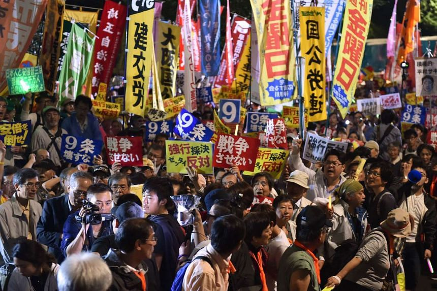 Demonstrators stage a rally against Japanese Prime Minister Shinzo Abe's controversial security bills in front of the National Diet in Tokyo.