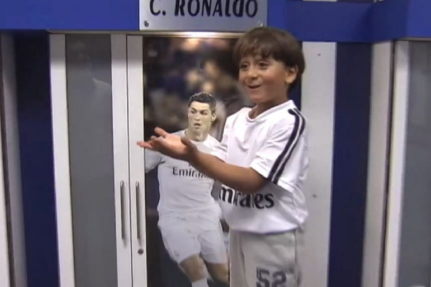 A screenshot from a video released by Real Madrid of the family's visit, with Zaid at player Cristiano Ronaldo's locker.