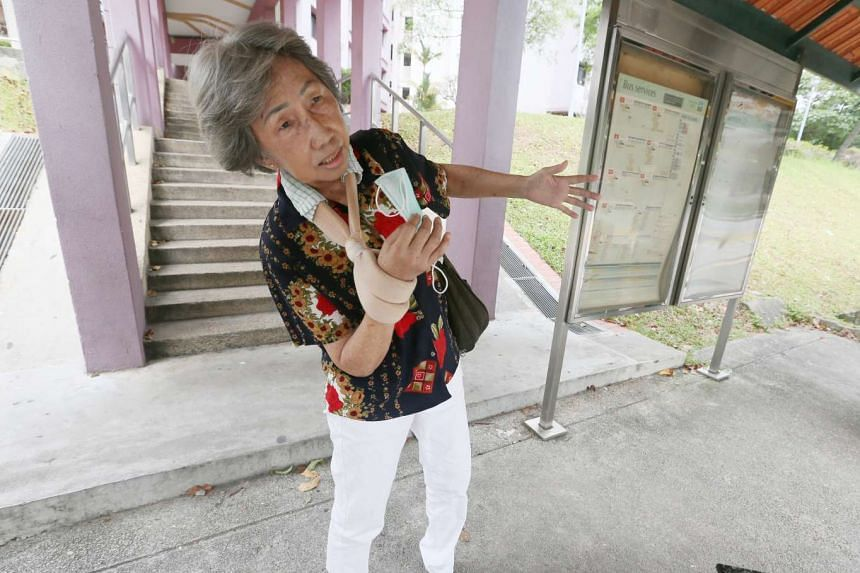 Madam Chng Kian, 69, describing how cyclist Lim Choon Teck, 35, collided into her on a pavement in Ang Mo Kio in May. Madam Chng ended up with fractures in her upper arm and wrist. Lim fled before Madam Chng's husband could take down his full details