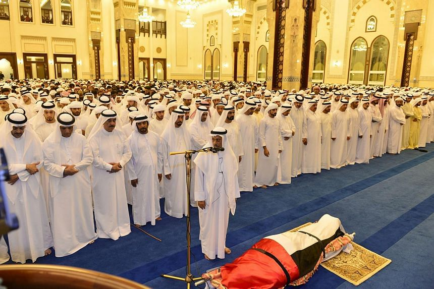Officials and mourners prepare to pray next to the body of Sheikh Rashid, son of the Prime Minister and Vice President of the United Arab Emirates Sheikh Mohammed bin Rashid al-Maktoum, during his funeral at a mosque in Dubai on Sept 19, 2015.