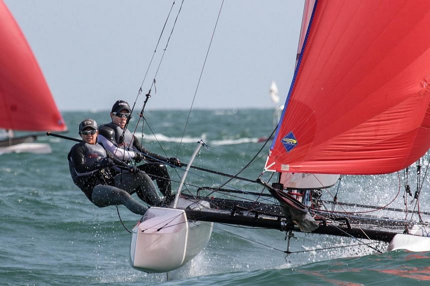 Sailors Justin Liu (right) and Denise Lim (left) made history by winning the Nacra 17 event at the Qingdao leg of the International Sailing Federation (Isaf) World Cup. They are the first Singaporeans to win a World Cup event.