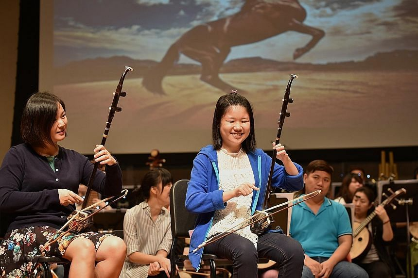 Ms Ow (in blue) rehearsing with the Singapore Chinese Orchestra.