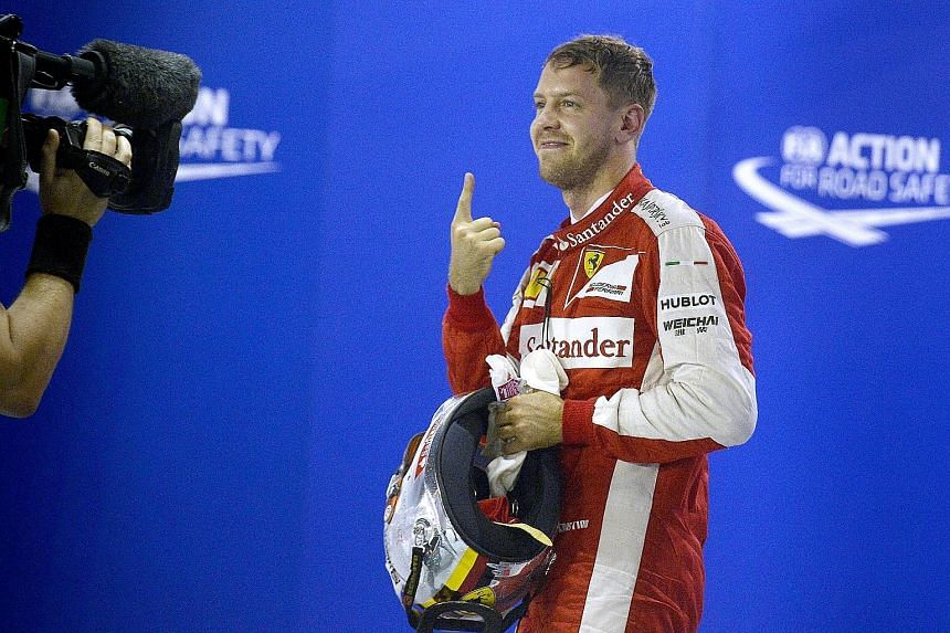 It's back! Sebastian Vettel's index-finger salute, that is. The German Formula One driver was celebrating snaring pole position last night for today's Singapore Airlines Singapore Grand Prix. It was Ferrari's first pole since the German Grand Prix in