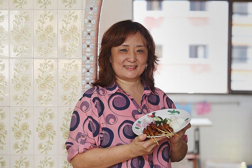 Ms Tan uses curry powder, lemongrass, blue ginger and cumin powder in the seasoning for her satay.