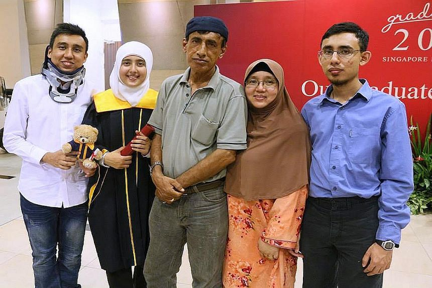(From left) Mr Farhan Noor with younger sister Nur Nazira, father Noor Mohamed, mother Amirjan and younger brother Luqman Nol Hakim. Mr Farhan had undergone an operation for a damaged spine.
