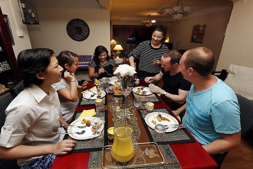 DRIVING STRANGERS AROUND: Reporter Ankita Varma driving an UberX car. STAYING IN A STRANGER'S HOME: Varma renting an Airbnb apartment in Tiong Bahru. HOSTING STRANGERS AT HOME: Varma whipping up dinner for paying guests in her home.