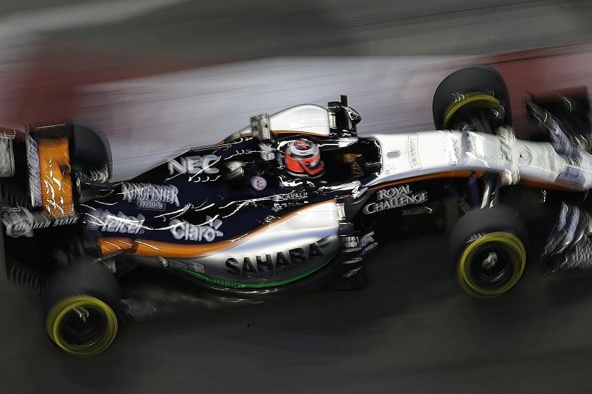 Force India driver Nico Huelkenberg during first practice, as seen from Swissotel The Stamford. F1 drivers are the most prolific jugglers in any sport, handling 25-odd buttons, knobs and an LCD screen on their steering wheels, while listening to thei