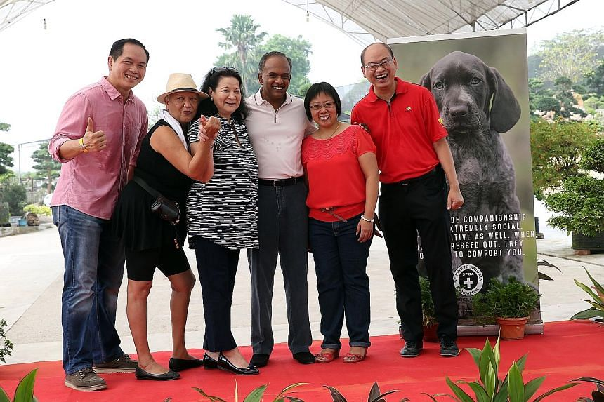 A fund-raising event for the shelter's new premises (above) was attended by (from left) Mr Kenny Eng, president of the Kranji Countryside Association; Mrs Ivy Singh-Lim; Ms Carla Barker, SPCA chairman; Mr K. Shanmugam, Ms Jasline Tan, director of Che