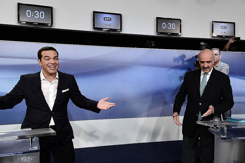 Mr Alexis Tsipras (far left), former Greek prime minister and leader of the left-wing Syriza party, taking part in a live pre-election televised debate with main opposition conservative New Democracy leader Vangelis Meimarakis last week.