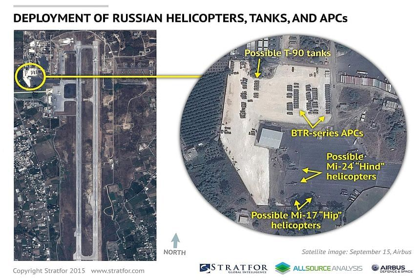 Airbus Defence and Space satellite images show a Russian AN-124 transport plane (far left) and possible Russian tanks and military helicopters (left) at the airbase at Latakia, Syria last week.
