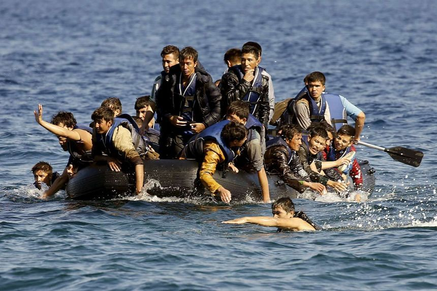 Afghan refugees call for help after their dinghy with a broken engine startes drifting out of control between the Greek island of Lesbos and the Turkish coast.