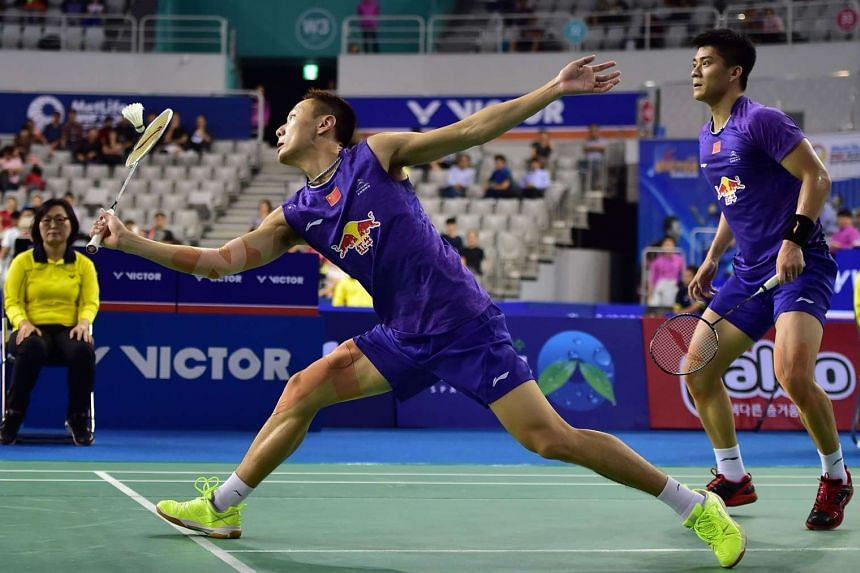 Fu Haifeng (right) and Zhang Nan (center) of China hit a return against Kim Gi-Jung and Kim Sa-Rang of South Korea during their men's doubles semi-final match at the Korea Open Superseries badminton tournament in Seoul on Sept 19, 2015.