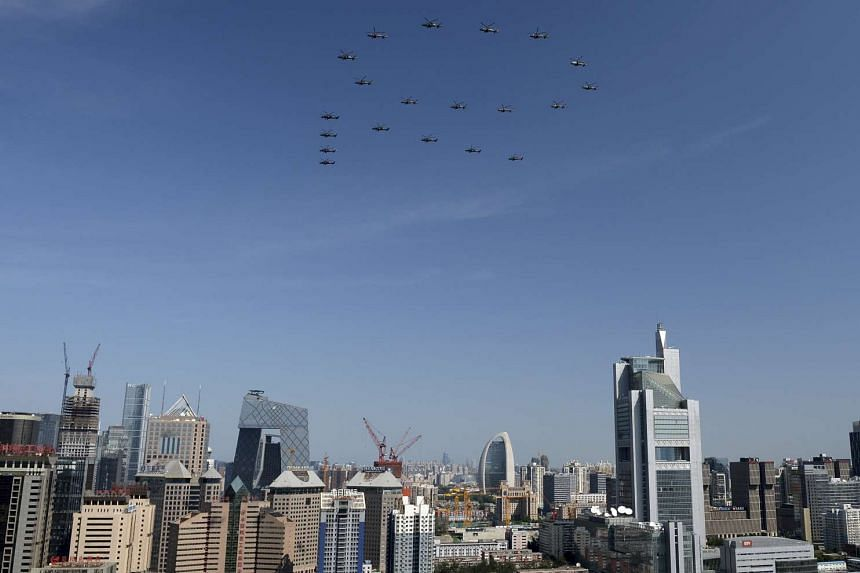 Air raid drills were held in some China cities on Saturday, with one academic linking the exercise to the 70th anniversary of the end of World War II, which was marked earlier this month with a military parade (above).
