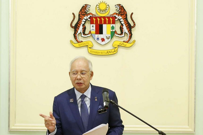 Former Malaysian prime minister Mahathir Mohamad has raised the possibility of current Prime Minister Najib Razak (above) being arrested if he leaves the country.