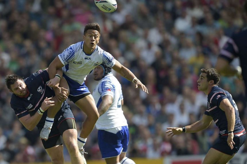 Samoa's fullback Tim Nanai-Williams (centre) jumps during the match between Samoa and USA on Sept 20, 2015.