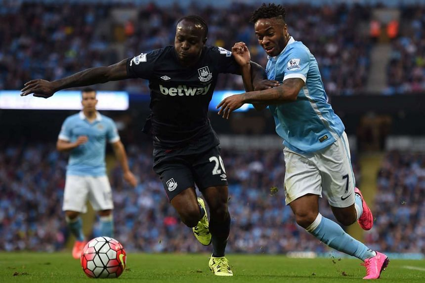 Manchester City midfielder Raheem Sterling (right) vies with West Ham United midfielder Victor Moses.