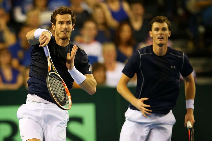 Britain's Andy Murray (left) and Jamie Murray in action.