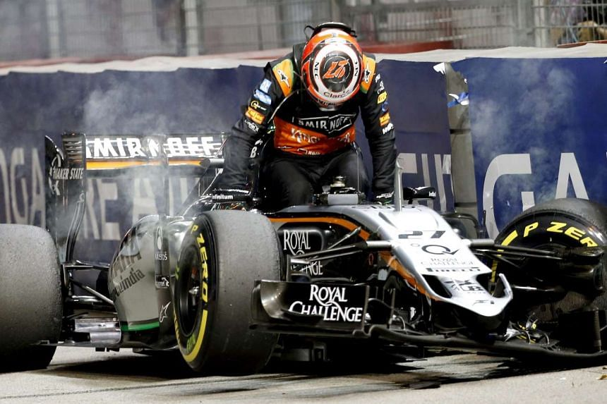 German Formula One driver Nico Hulkenberg of Sahara Force India F1 Team exits his car after crashing during the Singapore Formula One Grand Prix night race in Singapore, Sept 20, 2015.
