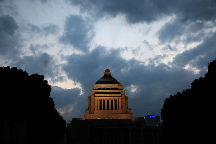 The National Diet building is illuminated during dusk in Tokyo on Sept 19, 2015 after Japan's Prime Minister Shinzo Abe's controversial security bills were passed during a session of parliament overnight.