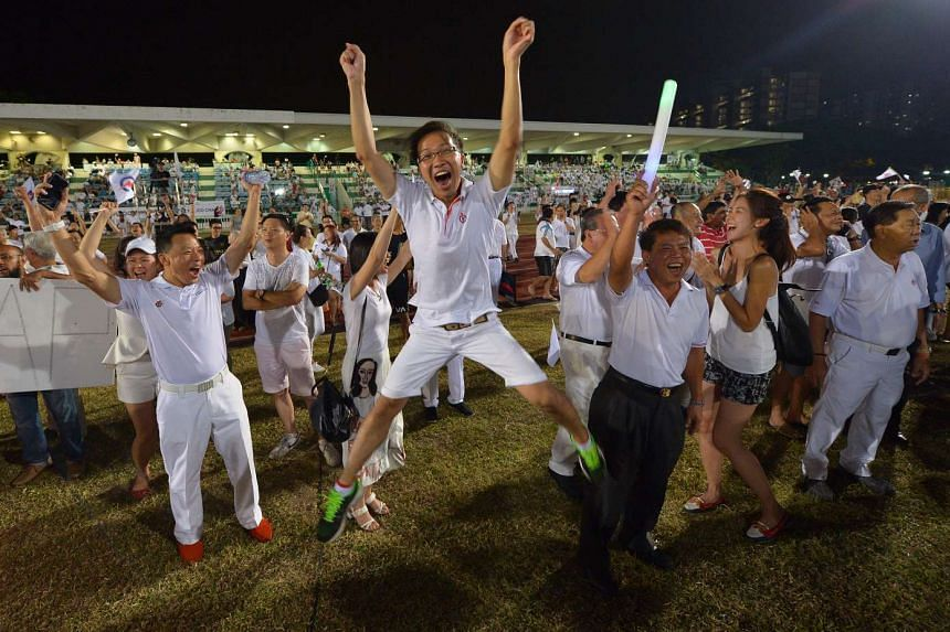 Mr Kenneth Wong, 30, a People's Action Party (PAP) activist with Marine Parade GRC, jumping for joy at Bedok Stadium.