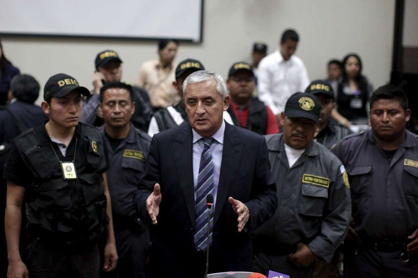 Former President Otto Perez speaks with the press after a hearing at the Supreme Court of Justice in Guatemala City, Guatemala on Sept 4, 2015.