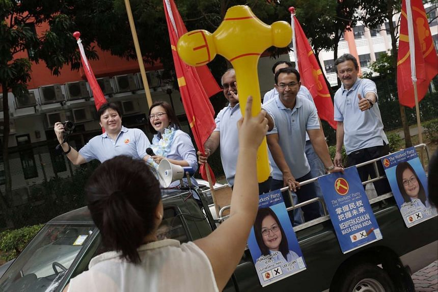 The winning PAP team in Marine Parade GRC on a thank-you parade last Sunday. WP's Ms Lee Li Lian (above), who lost in Punggol East SMC, thanking supporters in a procession around the area on Sept 12.