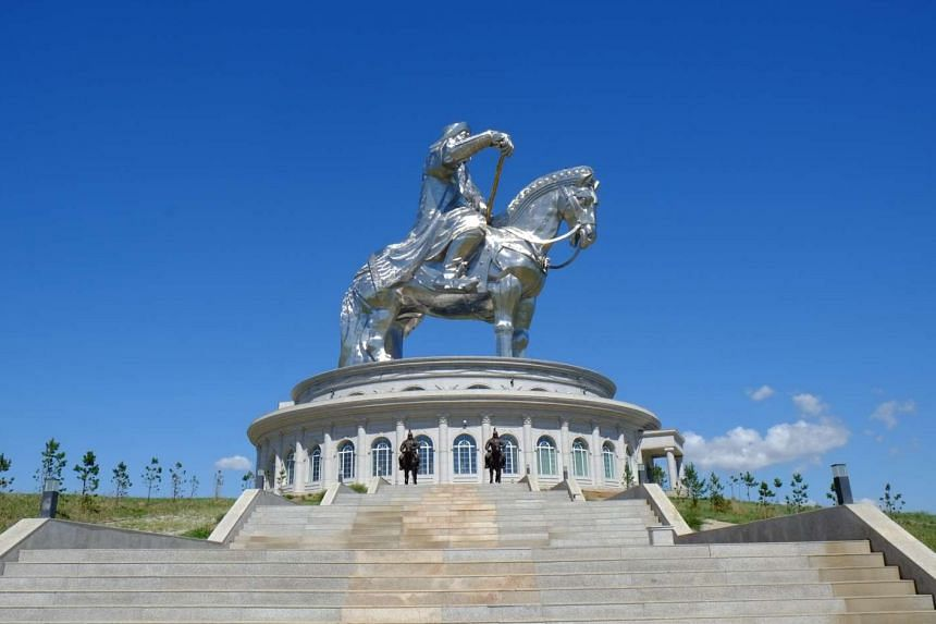 Animals such as goats roam the craggy slopes in Mongolia, and a tourist attraction near Ulan Bator – the 40m-tall Genghis Khan Equestrian Statue (above).