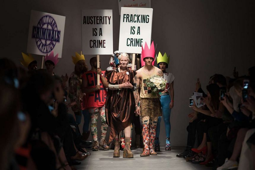 Designer Vivienne Westwood (centre) receives the applause following her presentation at the Spring / Summer 2016 London Fashion Week in London on Sept 20, 2015.