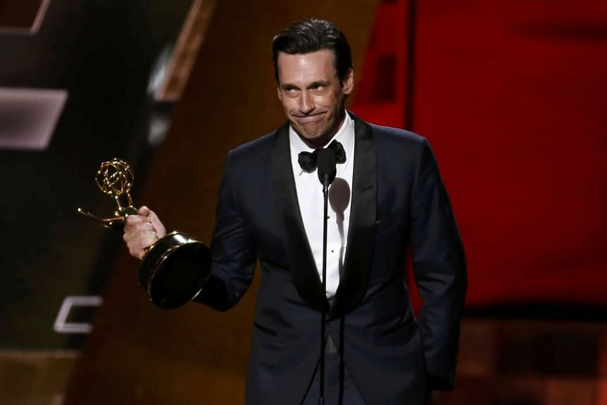 Jon Hamm accepts the award for Outstanding Lead Actor In A Drama Series for AMC's Mad Men at the 67th Primetime Emmy Awards.