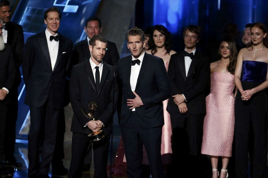 D.B. Weiss and David Benioff, with cast and crew, accepting the award for Outstanding Drama Series for HBO's Game of Thrones at the Emmy Awards.