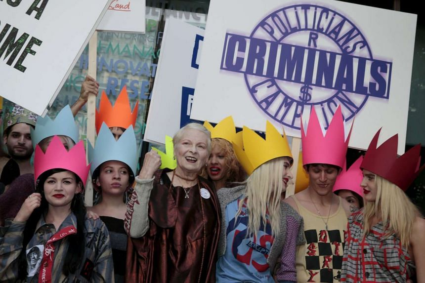 Fashion Designer Vivienne Westwood (3rd left) arrives with activists before the presentation of the Vivienne Westwood Red Label Spring/Summer 2016 collection during London Fashion Week on Sept 20, 2015.