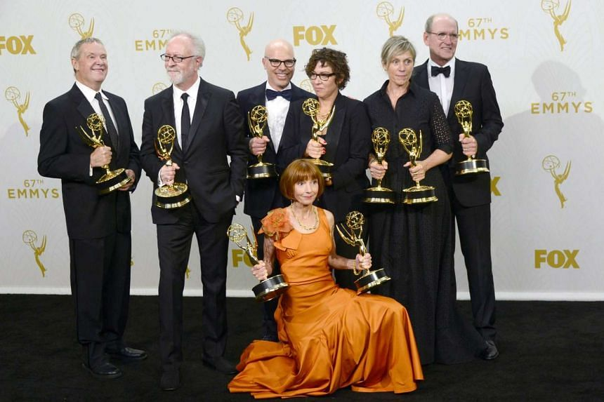 (From left to right) Producers David Coatsworth, Gary Goetzman, Steve Shareshian and Jane Anderson, director Lisa Cholodenko and actors Frances McDormand and Richard Jenkins, winners of the Outstanding Limited Series award for Olive Kitteridge.