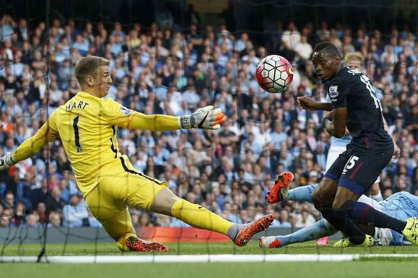 Diafra Sakho scoring the second goal for West Ham past goalkeeper Joe Hart to send Manchester City to their first league defeat of the English Premier League season.