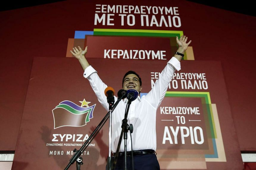 Mr Alexis Tsipras celebrating in Athens as he secures victory in the general election on Sept 20, 2015.
