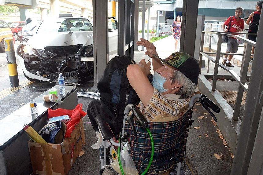 A wheelchair user had a lucky escape when a taxi crashed into a taxi stand outside a shopping mall and stopped just 2m away from him. Mr Yao Long Xiang, 69, could not react as quickly as other passers-by, who fled as the Mercedes-Benz rammed into a m
