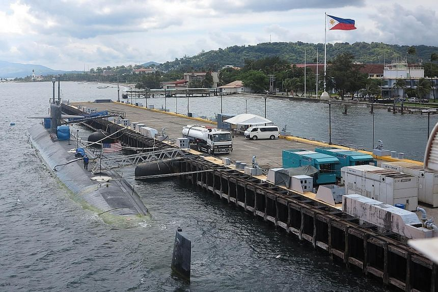 The USS Chicago, a Los Angeles-class fast-attack submarine, docking at Subic Bay port on Aug 6. Manila last year signed a 10-year agreement to allow the US to station troops, weapons and materials at bases in the Philippines, but the pact has been ti