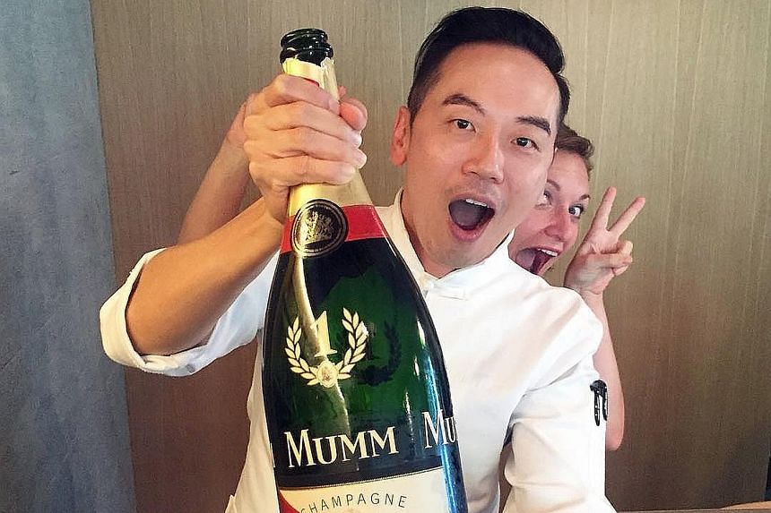 Restaurateur-chef Willin Low with last year's reserve bottle of the winner's Mumm champagne.
