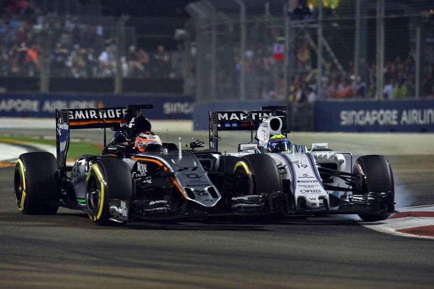 A collision between Nico Hulkenberg (left) and Felipe Massa on Lap 14 was one of the talking points of the Singapore Grand Prix.