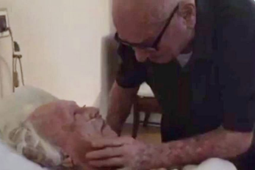 92-year-old Howard (right) stroking his dying wife Laura's face as he sings You'll Never Know.