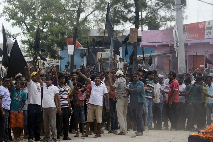 United Democratic Madhesi Front activists confront Nepalese police in Birgunj some 90 kms south of Kathamndu on Sept 20, 2015.